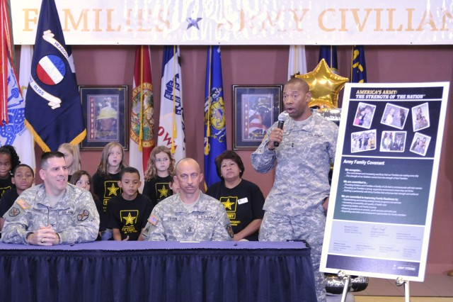 FORT BLISS, Texas -- Fort Bliss Commanding General Maj. Gen. Dana J. H. Pittard talks to the post\'s Soldiers, families and civilians during Fort Bliss' Nov. 4 Army Family Covenant signing ceremony at the 1st Armored Division Museum. Katherine Hammack (not pictured), the assistant secretary of the Army for installations, energy and environment, was on hand to sign the covenant and also toured the growing post and met with leaders, Soldiers, families and civilians. Also signing the covenant was (from left) Col. Joseph A. Simonelli Jr., Fort Bliss Garrison commander; Command Sgt. Maj. William A. Green, Fort Bliss Garrison command sergeant major; and (not pictured) Fort Bliss Command Sgt. Maj. David Davenport.