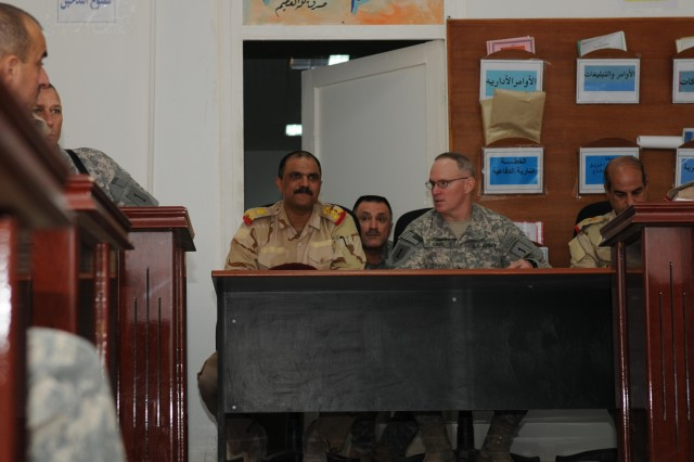 Brig. Gen. Ricky Gibbs, United States Division-South deputy commanding general for maneuver, talks to staff Brig Gen. Hussein, chief of staff of the 8th Iraqi Army Division, during a targeting board at an Iraqi compound near Camp Echo in the Diwaniyah Province Oct. 19. About 15 Iraqi Army officers attended the two-and-a-half hour briefing along with USD-S subject-matter experts from intelligence, operations and legal sections.