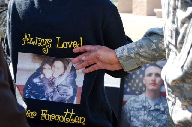 Some who attended the III Corps and Fort Hood Remembrance Ceremony Nov. 5, 2010, wore shirts with sentimental messages and pictures to pay tribute to their friends and family members who were killed Nov. 5, 2009.
