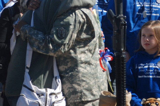 Nov. 5, 2010, was a day of healing for families and friends as they came together at the III Corps and Fort Hood Remembrance Ceremony to pay tribute to the 13 Soldiers and Civilians killed Nov. 5, 2009.