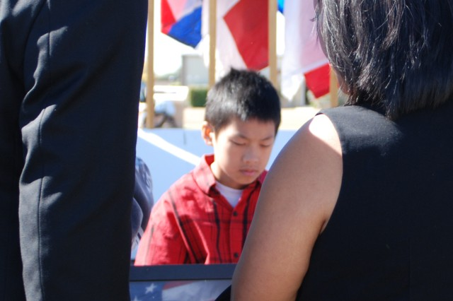 Private 1st Class Kham S. Xiong's family members surround his picture with grief at the end of the III Corps and Fort Hood Remembrance Ceremony Nov. 5, 2010.