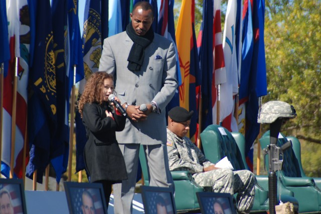 """Recording artists, Rhema Marvanne and Rick James, move the crowd with an emotional musical performance of """"The Prayer"""" during the III Corps and Fort Hood Remembrance Ceremony Nov. 5, 2010."""