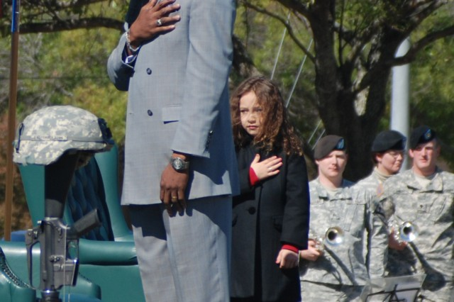 Recording artists, Rick James and Rhema Marvanne, render honors during the playing of the National Anthem at the III Corps and Fort Hood Remembrance Ceremony Nov. 5, 2010.