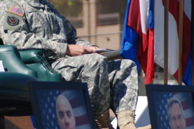 Chief of Staff of the Army Gen. George W. Casey, Jr., sits on stage behind photos of the 13 Soldiers and civilians killed Nov. 5, 2009.