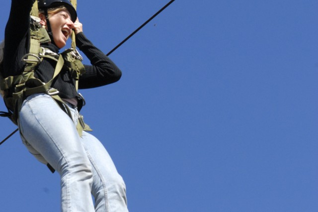 """Csilla Litchford  flings herself down the """"slide for life,"""" which simulates a parachute jump, during Saturday's Jane Wayne Day hosted by 2nd Battalion, 19th Infantry Regiment."""