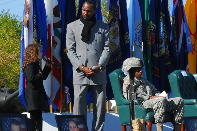 """Rhema Marvanne, 7, joins with recording artist Rick James to sing """"The Prayer"""" during a Remembrance Ceremony at Fort Hood, Texas, Friday. The ceremony commemorated the lives of 13 people who died in a tragic shooting incident on the installation Nov. 5, 2009."""
