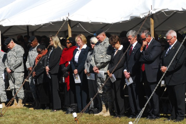 Army leaders bow their heads in reflection during a moment of silence on Fort Hood, Texas Friday. The entire installation paused at 1:41 p.m., one year, to the minute, after the tragic Nov. 5, 2009 shooting incident in remembrance of the 13 people who lost their lives that day. Hundreds attended the ceremony held on Cameron Field.
