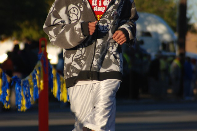 Richard Xiong, 14, finishes the one-mile Run to Remember Nov. 6 in honor of his brother Private 1st Class Kham Xiong who was killed Nov. 5, 2009, during the Fort Hood Shooting incident.