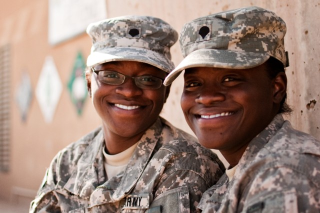 Spc. Paulette Dabney (left) and Spc. Georgette Steele, twins from Chesapeake, Va., serve as Army aviation operations specialists in Iraq. The twins joined the Army together in 2008, and have stayed together since. Together they attended Basic Combat Training, Advanced Individual Training, and are now deployed with the Enhanced Combat Aviation Brigade, 1st Infantry Division. As aviation operations specialists, the twins are responsible for tracking flights, communicating with aircraft, and keeping commanders updated.