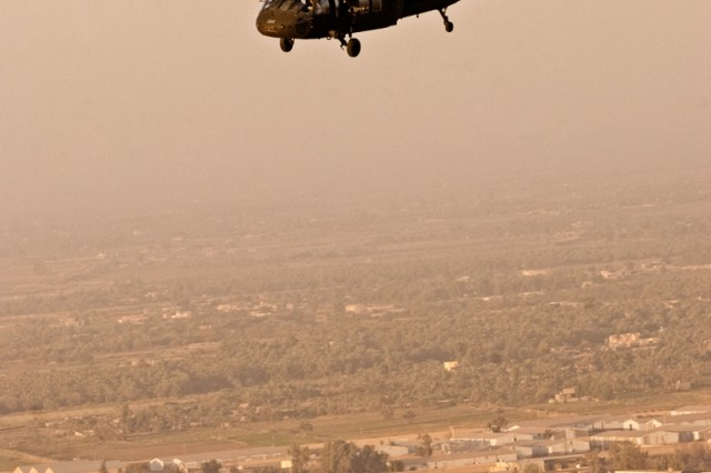 An Army Black Hawk helicopter with the Enhanced Combat Aviation Brigade, 1st Infantry Division flies above Baghdad during a routine mission, Nov. 5. (U.S. Army photo by Spc. Roland Hale, eCAB, 1st Inf. Div. PAO)