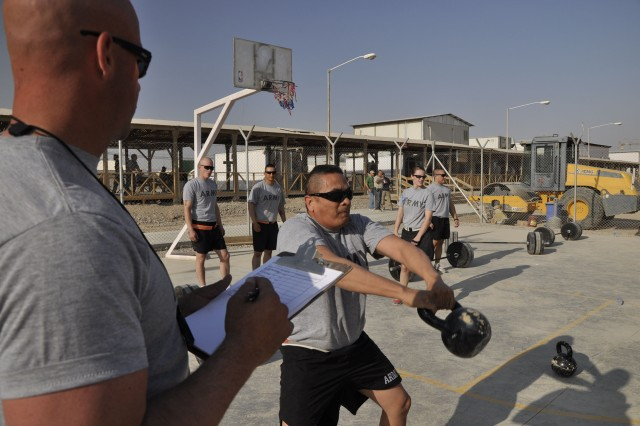 Sgt. 1st Class Amador Cruz from Headquaters and Headquarters Company, 20th Engineer Battalion, performs a kettlebell swing during the battalion's memorial Cross-fit competition at Kandahar Airfield, Afghanistam, to honor Soldiers from the battalion killed or wounded in the shooting incident at Fort Hood Nov. 5, 2009.