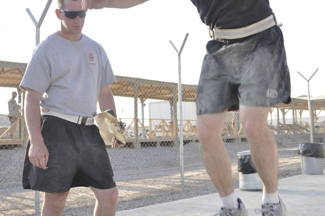 Capt. James Pence, commander of the 510th Engineer Company, 20th Engineer Battalion, performs the box jump event of the Cross-Fit competition at Kandahar Airfield, Afghanistan, Nov. 5. Participants were required to perform 20 repetitions of jumping up onto the box after having completed several other events.