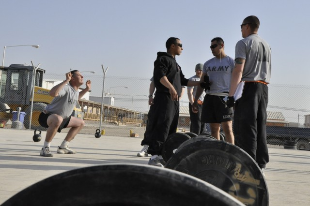 Soldiers from the 20th Battalion, 36th Engineer Brigade prepare to compete in a memorial Cross-Fit competition at Kandahar Airfield, Afghanistan, Nov. 5, to honor four Soldiers from the battalion killed in the Fort Hood shooting in November of 2009.