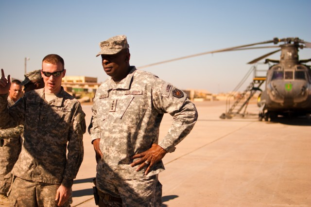 U.S. Forces-Iraq Commander Gen. Lloyd Austin talks with a Soldier serving in Iraq in the Enhanced Combat Aviation Brigade, 1st Infantry Division, during a visit to Camp Taji, Iraq, Nov. 6. (U.S. Army photo by Spc. Roland Hale, eCAB, 1st Inf. Div. PAO)