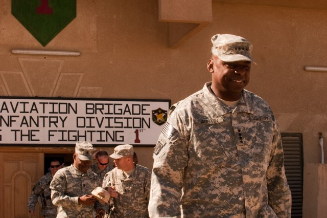 U.S. Forces-Iraq Commander Gen. Lloyd Austin departs the Enhanced Combat Aviation Brigade, 1st Infantry Division's headquarters after a visit to Camp Taji, Iraq, Nov. 6. Behind Austin walk Command Sgt. Maj. Joseph Allen, the senior enlisted Soldier in Iraq, and Command Sgt. Maj. Jim Thomson,  the senior enlisted Soldier of the eCAB, 1st Inf. Div. (U.S. Army photo by Spc. Roland Hale, eCAB, 1st Inf. Div. PAO)