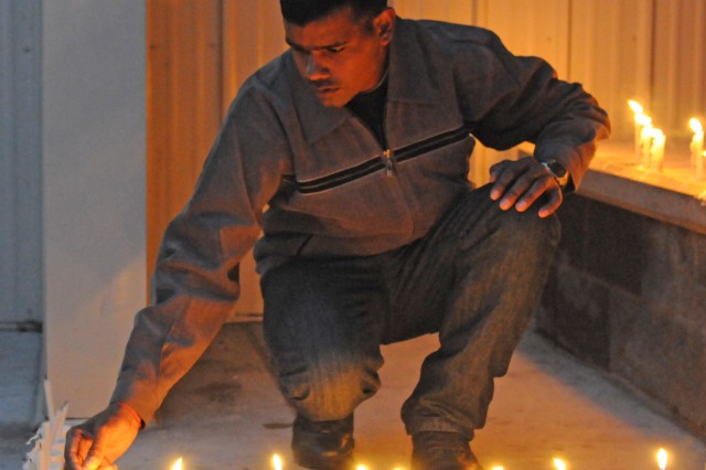 An Indian Army soldier lights candles Nov. 5 during a Diwali festival celebrated with Soldiers from the Indian Army and U.S. Army Alaska at the Wilderness Inn dining facility on Joint Base Elmendorf-Richardson, Alaska.