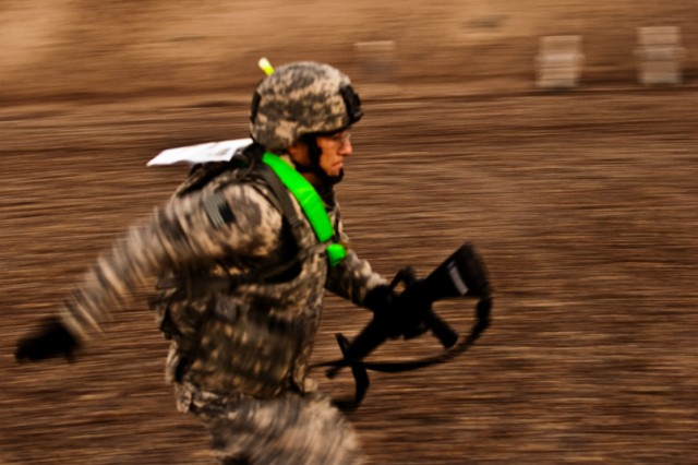 Sgt. Richard Mansford, a Soldier serving on Camp Taji, Iraq, with the Enhanced Combat Aviation Brigade, 1st Infantry Division, sprints across a range, Nov. 7, during Demon Fury, a competition designed to test the full spectrum of Soldiers' combat skills.