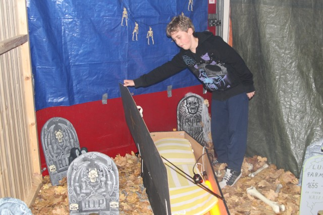 Twelve-year old Micheal DAfA1/4nchner, volunteer fire department recruit, makes last minute preparations and checks of the haunted house in Lengfeld, Oct. 29.