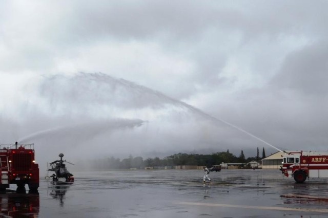 Fire rescue engines spray a OH-58D Kiowa Warrior as they simulate extinguishing a downed aircraft during a readiness exercise using pilots and aircraft, assigned to 2nd Squadron, 6th Cavalry Regiment, 25th Combat Aviation Brigade, on Wheeler Army Airfield, Oct. 26.