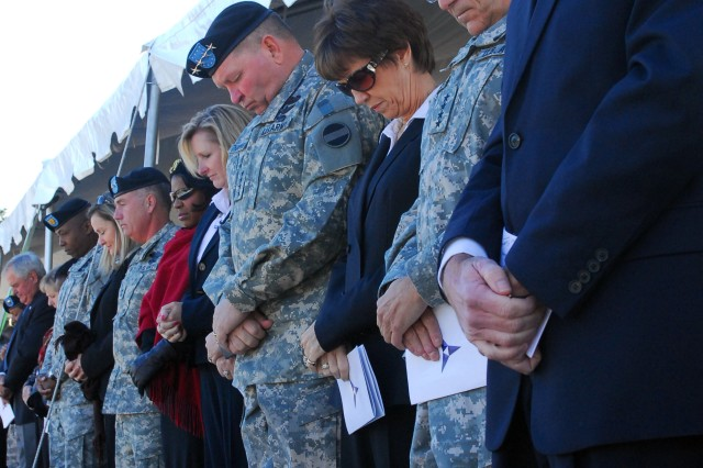 Heads bow in memory at Hood