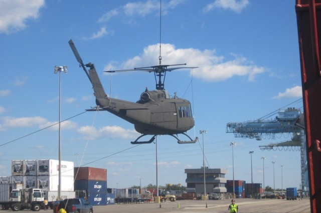 The UH-1H being lifted to the BBC Houston.