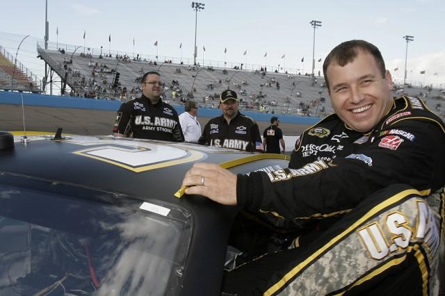 NASCAR driver Ryan Newman slips into the Army No. 39 Chevrolet Impala SS at Phoenix International Raceway.