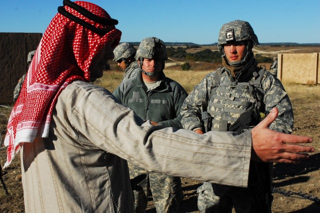 FORT HOOD, Texas- 1st Lt. Ross Cargile (right), a platoon leader with 3rd Battalion, 82nd Field Artillery Regiment, 2nd Brigade Combat Team, 1st Cavalry Division, talks to a local village leader through an interpreter during training on Fort Hood, Texas, Nov. 5.