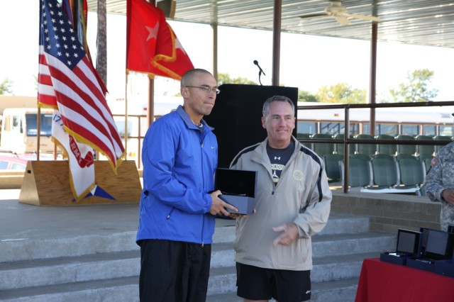 FORT HOOD, Texas-Spc. Shawn Richards (left), an infantryman from Company B, 2nd Battalion, 8th Cavalry Regiment, 1st Brigade Combat Team, 1st Cavalry Division, receives the award for the best overall time in male category for the half-marathon, here, Nov. 6.