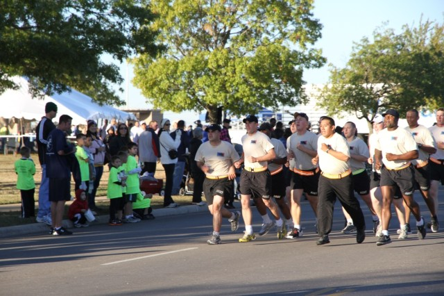 "FORT HOOD, Texas - Soldiers from Company A, 2nd Battalion, 8th Cavalry Regiment, 1st Brigade Combat Team, 1st Cavalry Division, ran the five kilometer run together at the ""Run to Remember"" honoring those from the Nov. 5, 2009 shootings at Fort Hood, Nov. 6."