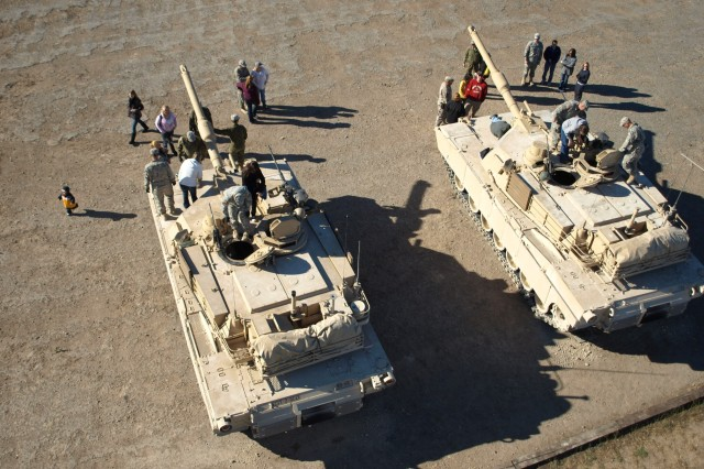 FORT HOOD, Texas - Family members of the 2nd Battalion, 8th Cavalry Regiment, 1st Brigade Combat Team, 1st Cavalry Division, explore an M1A2 Abrams tanks on display for the Stallion Family Day Gunnery, here, Nov. 5.