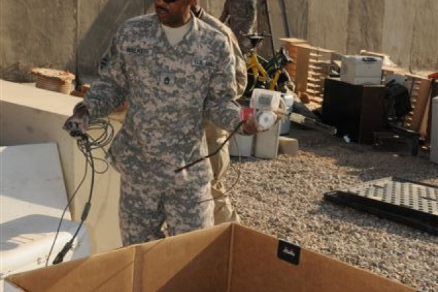 Sgt. 1st Class Larry Walker, a native of Palm Harbor, Fla., and the noncommissioned officer-in-charge of the mobile redistribution teams for Operation Clean Sweep with 319th Transportaion Company, inspects excess supplies from the Navy Riverine Squadron 1 deployed in Basra Nov. 4. The theater-wide operation is an effort to save millions of taxpayer dollars by identifying and properly routing excess equipment.
