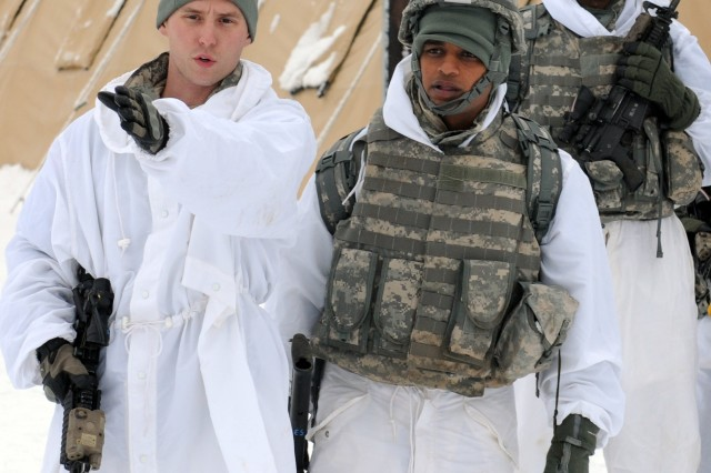 Sgt. Joshua Smith, a team leader with Bravo Troop, 1st Squadron (Airborne), 40th Cavalry Regiment, 4th Brigade Combat Team (Airborne), 25th Infantry Division, explains wedge formation procedures to an Indian soldier during a demonstration of movement techniques and hand-and-arm signals. The demonstration was part of training with Indian army soldiers on U.S. Army troop leading procedures at Forward Operating Base Sparta on Joint Base Elmendorf-Richardson, Alaska, Nov. 8. Training was conducted to prepare troops from both 1-40th CAV and the Indian army for a zone reconnaissance mission to kick off the field-training exercise portion of combined training exercise Yudh Abhyas 2010.