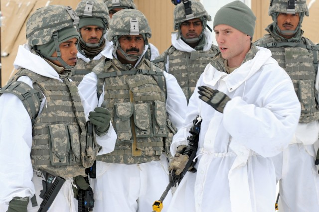 Sgt. Joshua Smith, a team leader with Bravo Troop, 1st Squadron (Airborne), 40th Cavalry Regiment, 4th Brigade Combat Team (Airborne), 25th Infantry Division, shows Indian soldiers the hand-and-arm signal for a linear danger area during a demonstration of movement techniques. The demonstration was part of training with Indian army soldiers on U.S. Army troop leading procedures at Forward Operating Base Sparta on Joint Base Elmendorf-Richardson, Alaska, Nov. 8. Training was conducted to prepare troops from both 1-40th CAV and the Indian army for a zone reconnaissance mission to kick off the field-training exercise portion of combined training exercise Yudh Abhyas 2010.