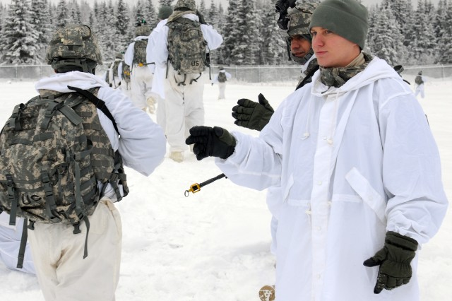 Sgt. Orrin Turner, a section leader with Bravo Troop, 1st Squadron (Airborne), 40th Cavalry Regiment, 4th Brigade Combat Team (Airborne), 25th Infantry Division, and an Indian army soldier take a head count as troops go out on patrol during training on U.S Army troop leading procedures at Forward Operating Base Sparta on Joint Base Elmendorf-Richardson, Alaska, Nov. 8. Training was conducted to prepare soldiers from both 1-40th CAV and the Indian army for a zone reconnaissance mission to kick off the field-training exercise portion of combined training exercise Yudh Abhyas 2010.