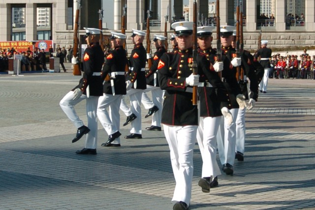 """The U.S. Marine Corps Silent Drill Team performs Nov. 10 at the commemoration ceremony for the 60th anniversary of the Jangjin """"Chosin"""" Reservoir battle."""
