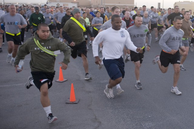 CAMP ARIFJAN, Kuwait - Servicemembers take off at the beginning of the Third Army 5K Birthday Run at Camp Arifjan, Kuwait, Nov. 7. Third Army celebrated its 92 years of history, ranging from its mission in the trenches of Germany during WWII to their current mission of balancing a complex logistical mission in support of the Warfighters in Iraq and Afghanistan from Kuwait, by participating in a 5-km. run. (U.S. Army photo by Sgt. Ryan Hohman)