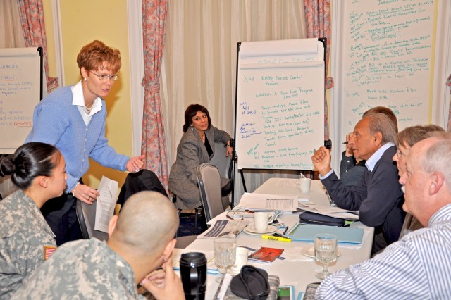 Camille Howes of the U.S. Army Garrison Wiesbaden Plans, Analysis and Integration Office, facilitates a safety team planning session during the U.S. Army Garrison Wiesbaden Strategic Planning Conference.