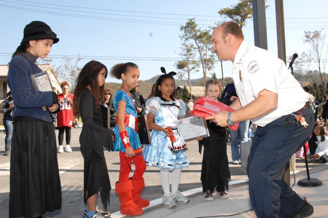 Fire officials present poster, essay awards