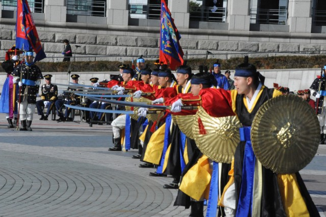 "The Republic of Korea Ministry of National Defense Honor Guard performs Nov. 10 at the commemoration ceremony for the 60th anniversary of the Jangjin ""Chosin"" Reservoir battle."