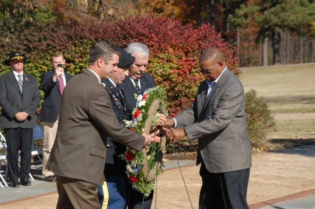 Congressman Rob Wittman; Lt. Col. Jack Haefner, garrison commander; U.S. Navy Retired Capt. Jim Day, co-chair, Installation-Community Council; and, U.S. Army Retired Master Sgt. Jimmie L. Randle, directorate of logistics, lays a wreath to honor all Veterans who served and continue to serve this nation during Fort A.P. Hill's Veterans Day Observance, Nov. 9.