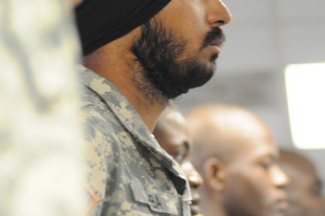 Spc. Simranpreet Lamba joins 12 other Soldiers in a naturalization ceremony Wednesday morning at Fort Jackson. Lamba, a Sikh whose articles of faith include having unshorn hair covered by a turban and keeping a beard, is the first enlisted Sikh Soldier in at least 26 years who has been granted religious accommodations by the Army, allowing him to adhere to his articles of faith. Lamba graduated from Basic Combat Training Wednesday.