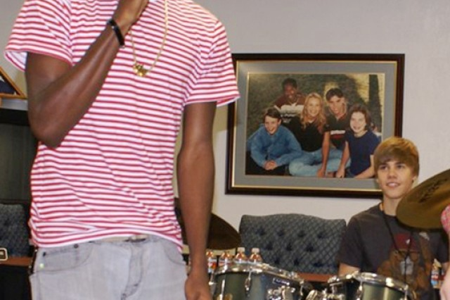 Cole Senior Wesley McGhee raps with Justin Bieber on drums at a special guest appearance at Cole Middle and High School Nov. 5 during a surprise visit by the pop star. Twenty-three randomly-selected Middle and High School students also received tickets to Bieber's concert held later that night.