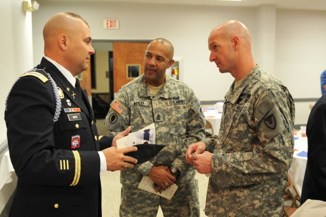 After the program, Maj. Jefferey Lewis, right, and Anniston Army Depot Sgt. Maj. Tony Butler, center, chat with Lt. Col. Richard White, professor of military science with Jacksonville State University's Reserve Officer Training Corps.
