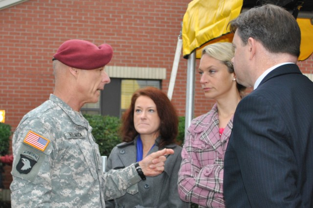 Lt. Gen. Frank G. Helmick, commander, 18th Airborne Corps and Fort Bragg, discusses the new Army Wellness Center with Renee E. Johnson, Fort Bragg health promotion officer, Kym Ocasio, Health Promotion Operations at USAPHC (Prov), and Todd Hoover, director of Army Wellness Centers-Europe, key players in coordinating the new AWC.