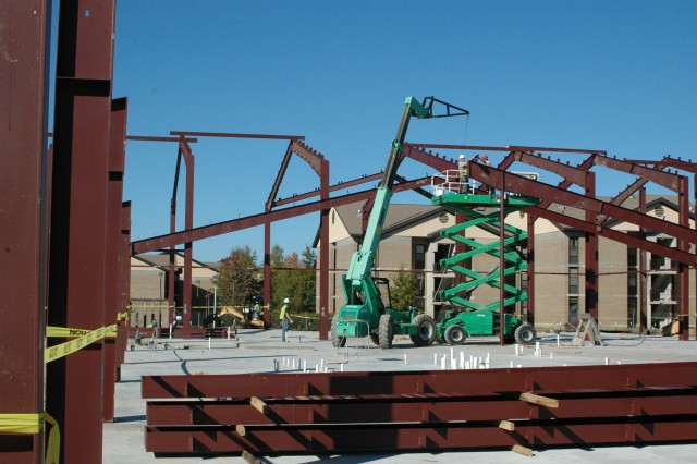 "(FORT BRAGG, N.C. - 10 NOV 2010) Once all the ""red iron"" beams are erected for the Army Ground Forces Band building, metal decking for the roof will be installed, a task that should be completed by Thanksgiving if all goes as planned. The band will move to Fort Bragg with Headquarters, U.S. Army Forces Command (FORSCOM), the summer of 2011, in accordance with the 2005 Base Realignment and Closure legislation. The AGFB falls under the operational control of FORSCOM."