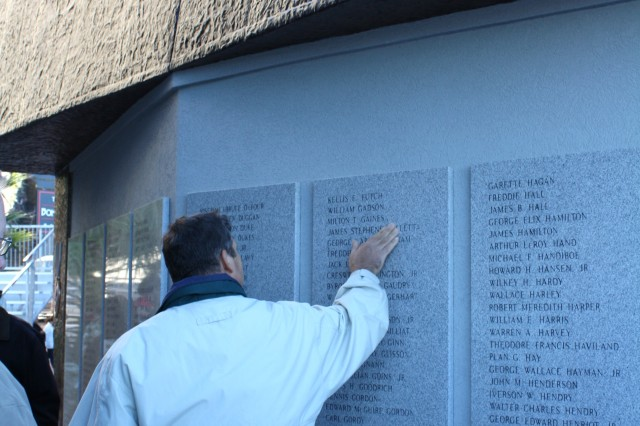 Citizens search the wall of the World War II memorial for specific names of fallen veterans. Included are all 527 service members from Chatham County who lost their lives during the war.