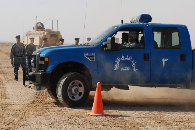 Sergeant Chris Roman (in driver's seat), with the 442nd MP Co., 4th AAB, 3rd ID, teaches Iraqi Police defensive driving techniques in Anbar province, Iraq, Oct. 30.