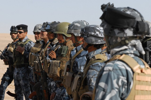 Members of an Iraqi Police personnel security detachment learn defensive driving techniques during a class taught by Soldiers with the 442nd MP Co., 4th AAB, 3rd ID, Oct. 30.