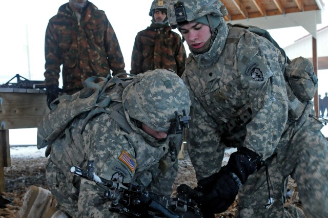 Spc. Daniel Amstutz (left) scout, Bravo Troop, 1st Squadron (Airborne), 40th Cavalry Regiment, 4th Brigade Combat Team (Airborne), 25th Infantry Division, and Spc. Braidy Allen, scout, Bravo Troop, 1-40 CAV, 4th ABCT, 25th ID, demonstrate emplacement of the M-240 machine gun to Indian army soldiers. The training was conducted at one of the airborne sustainment training areas Nov. 9 in preparation for missions involved in the field training exercise portion of Yudh Abhyas 2010.