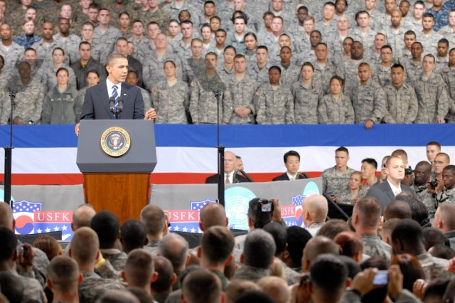 To honor the men and women in uniform, President Barack Obama takes time to meet with Servicemembers who have left family and friends behind to serve overseas, in observance of Veterans' Day while at United States Army Garrison Yongsan, Nov. 11.